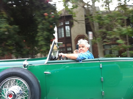 Jay Leno driving a vintage car