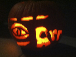 ARR carved into the side of the pumpkin